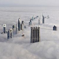 thumbnails-dubai_skyscrapper_clouds_top_bird